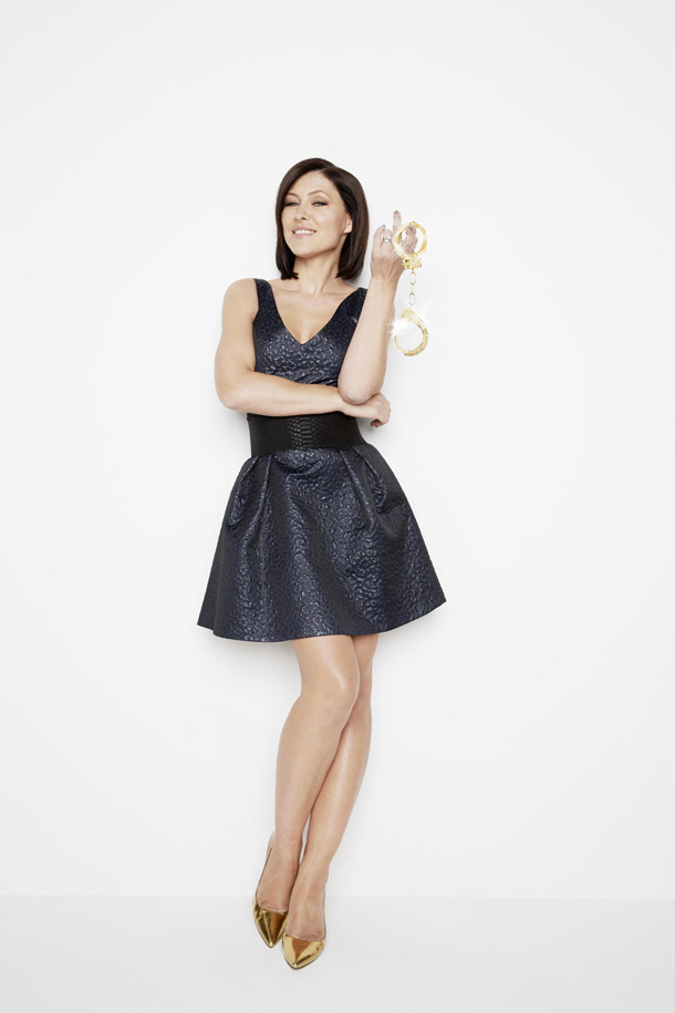 Celebrity Big Brother 2014 presenters - Emma Willis poses with handcuffs for launch twist